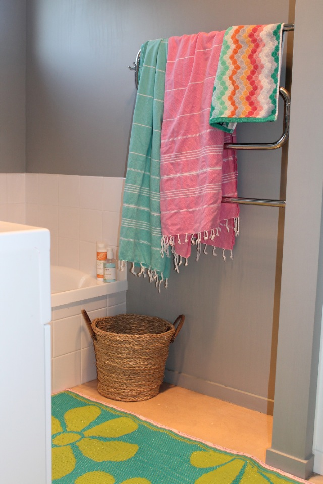 hammamas cotton beach towels styled in the bathroom add colour